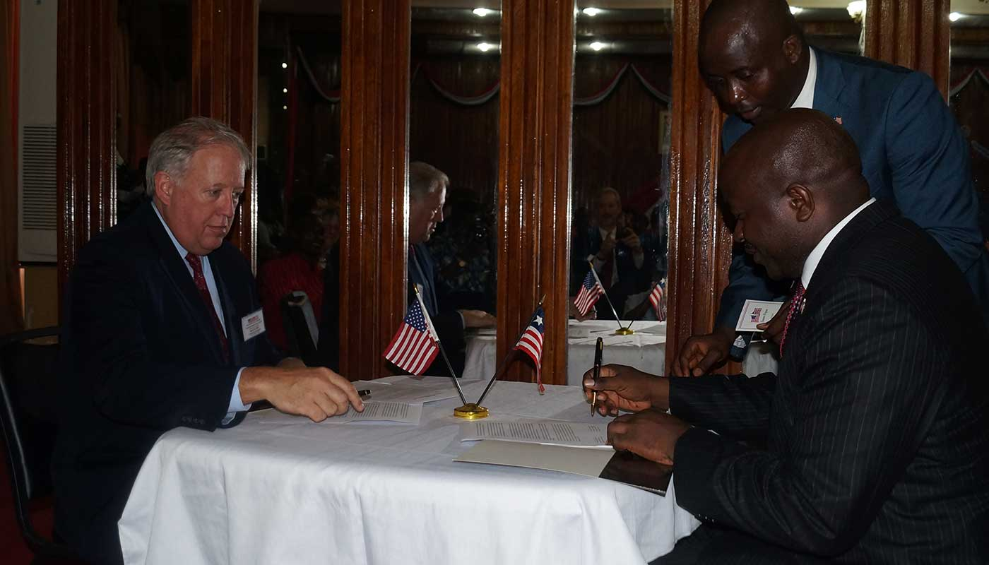 Amb. Thomas A. Shannon and Foreign Minister Augustine K. Ngafuan sign joint communique at the Ministry of Foreign Affairs in Monrovia, Liberia