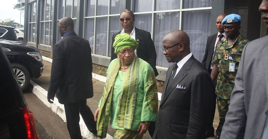 Chief Justice Korkpor escorts President Sirleaf to her vehicle after the opening of the October term of the Supreme  Court on Monday, October 12, 2015
