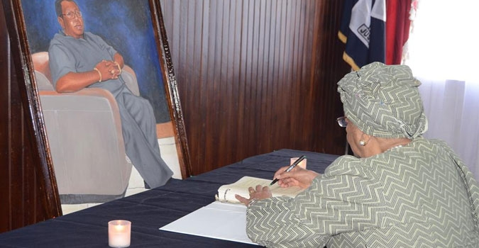 President Sirleaf Signs Book of Condolence for the Late Cllr. Clarence L. Simpson, Jr.