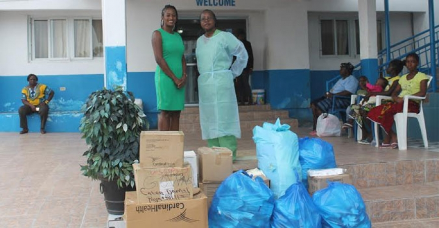 Paynesville City Mayor Cyvette Gibson and a staff of the Hope for Women Medical Center along with the Medical supplies