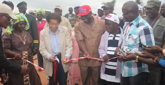 President Sirleaf cuts the ribbon to the rehabilitated 86 kilometer Barclayville-Kanweaken Road.JPG