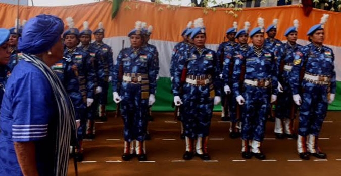 President Sirleaf Inspects a unit of the Indian Female Police Force.